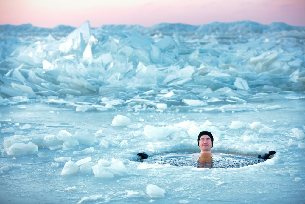 Man in ice hole