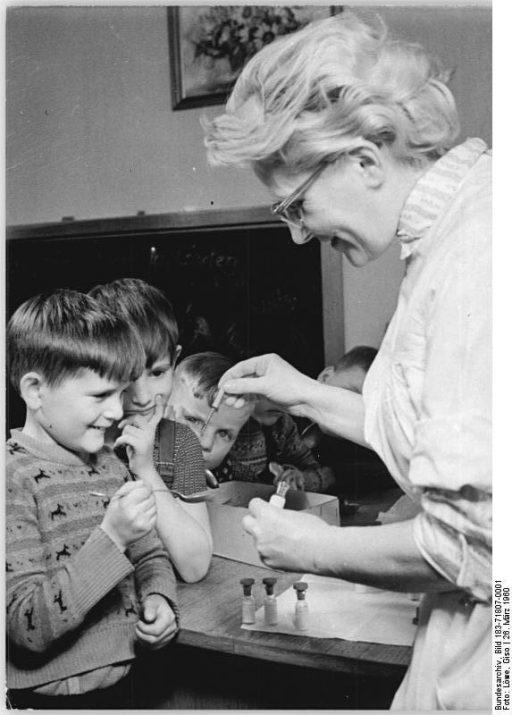 Happy kids getting vaccines in 1950